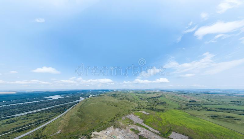 Aerial 180 degree of beautiful picturesque landscape with panoramic deep sky with clouds, natural green fields and meadows royalty free stock photos