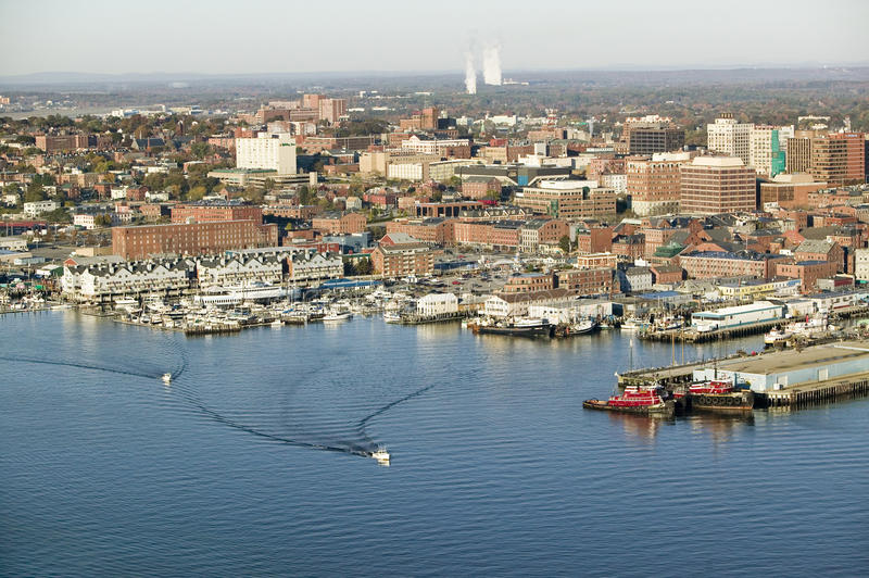 Aerial of downtown Portland Harbor and Portland Maine with view of Maine Medical Center, Commercial street, Old Port and Back stock photography