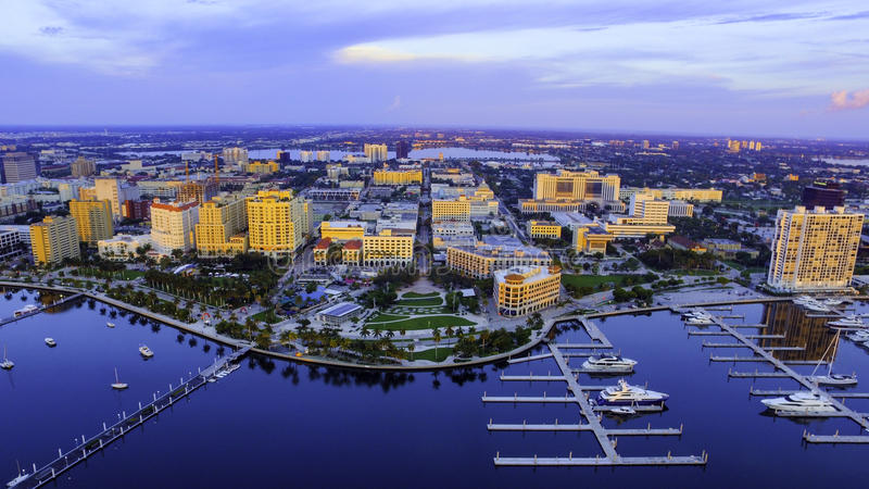 Aerial downtown west palm beach florida. Aerial shot of downtown west palm beach, florida looking west down clematis street catching a glance of the yacht docks royalty free stock images