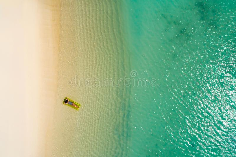 Aerial drone aerial view of Beautiful girl having fun on the sunny tropical beach. Seychelles stock image