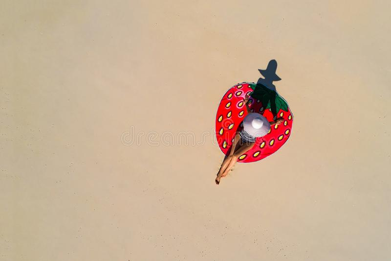 Aerial drone aerial view of Beautiful girl having fun on the sunny tropical beach. Seychelles stock photo