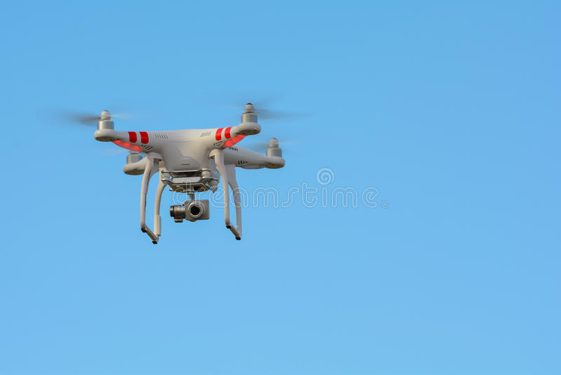 Download Aerial Flying Drone Against Blue Sky Stock Photo - Image: 48606442