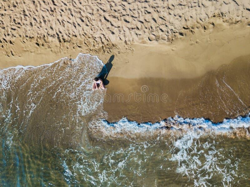 Girl having fun on the tropical beach. Aerial drone bird`s eye view photo. royalty free stock photography