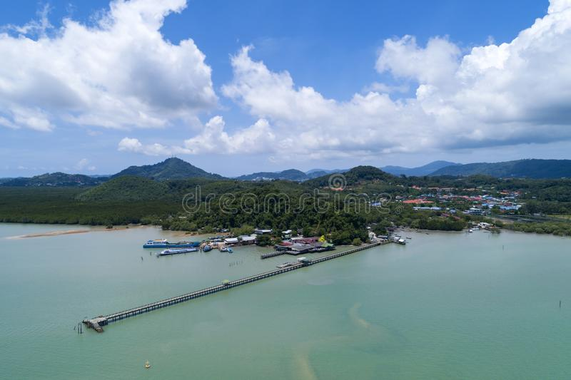 Aerial drone bird`s eye view photo of small bridge in to the sea in beautiful island at phuket thailand royalty free stock photography