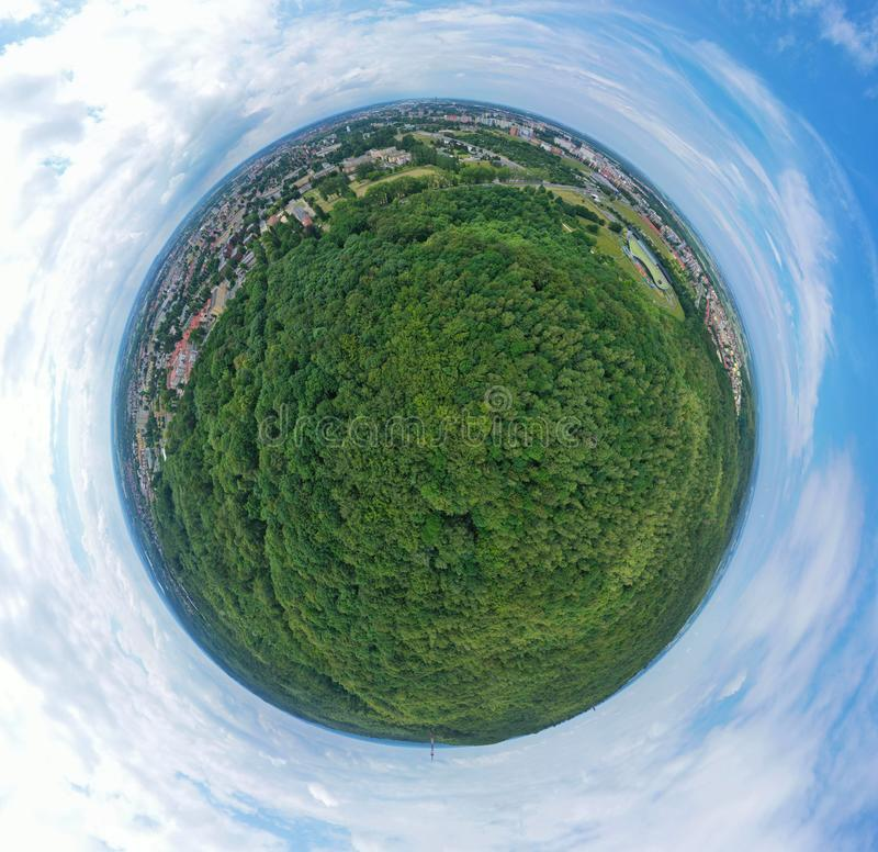 Aerial drone 360 degree panoramic view on green lungs forest surrounding european city during summer, aquapark complex stock photography