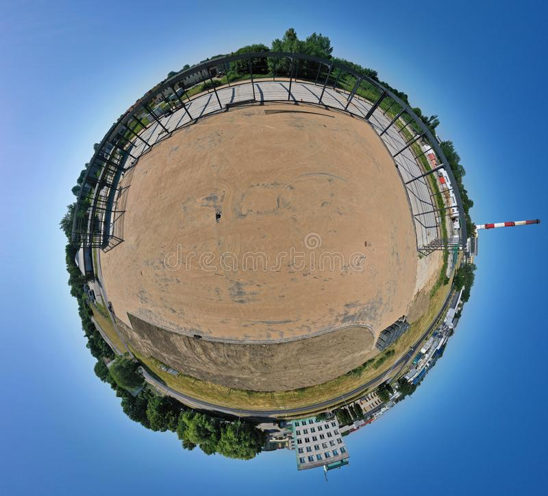 Aerial drone 360 degree spherical view on steel construction frame, on building site, concrete floor with metal pipe supports and royalty free stock image