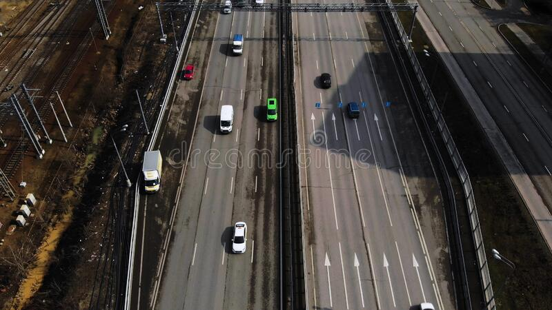 Aerial drone flight over road traffic. Follow shot of green wagon. Aerial drone flight over road traffic stock photos