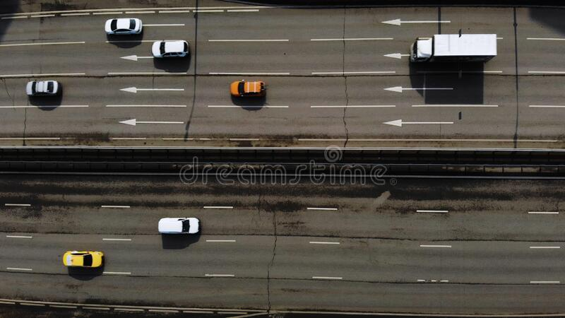 Aerial drone flight over road traffic. Static shot of motorway. Aerial drone flight over road traffic stock photo