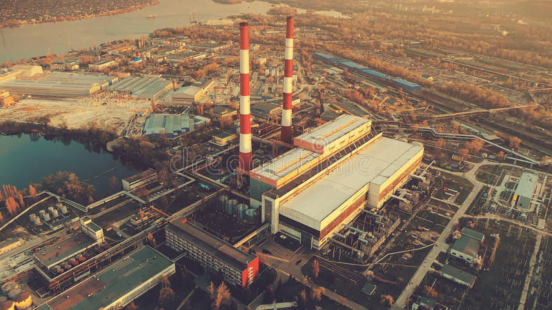 Aerial Drone Flight Photo of city main Power plant with two factory chimneys stock photography