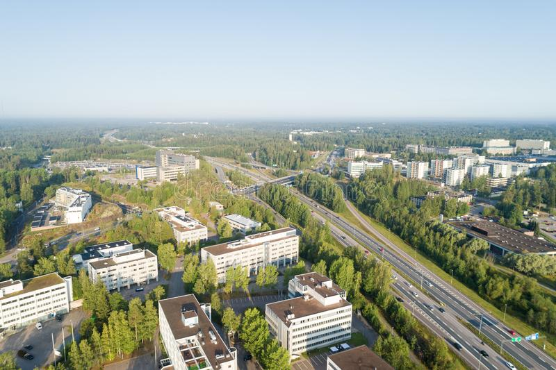 Aerial Drone Flight Photo of highway with cars and trucks. Road Junction in the big city. Top view. Cityscape in sunset soft light royalty free stock photography