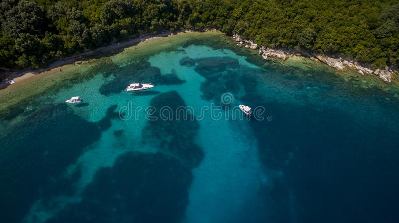 Aerial drone footage of a bay and boats in North Corfu Greece. Amazing Greece royalty free stock images