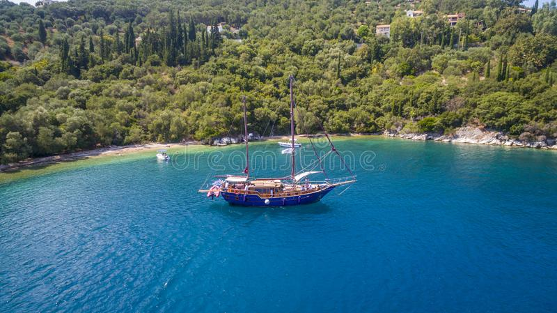 Aerial drone footage of a bay and boats in North Corfu Greece. Amazing Greece stock photo
