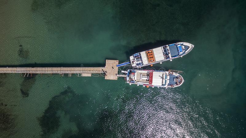 Aerial drone image of a bay and boats at North Corfu Greece. Amazing Greece royalty free stock photo