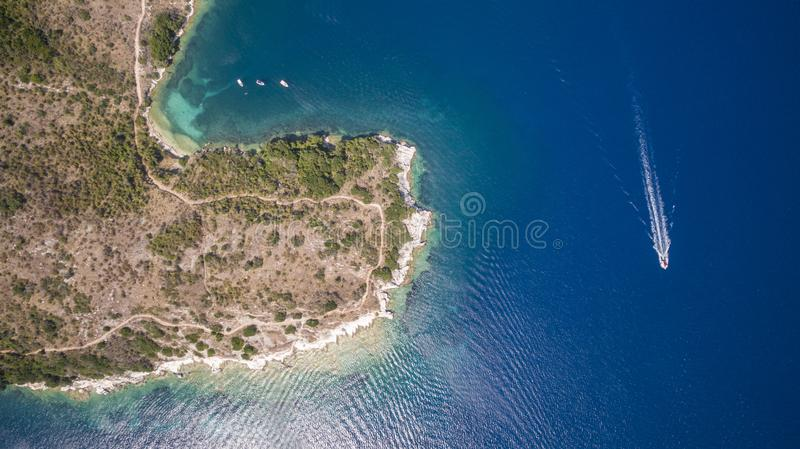 Aerial drone image of a bay and boats at North Corfu Greece. Amazing Greece royalty free stock photos