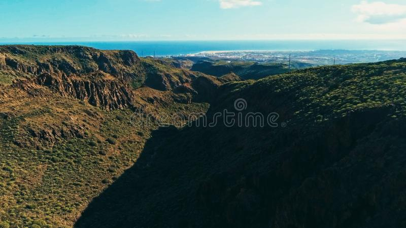aerial drone image of beautiful stunning landscape cliffs and valleys and Maspalomas and playa ingles in the background on a sunny royalty free stock photography