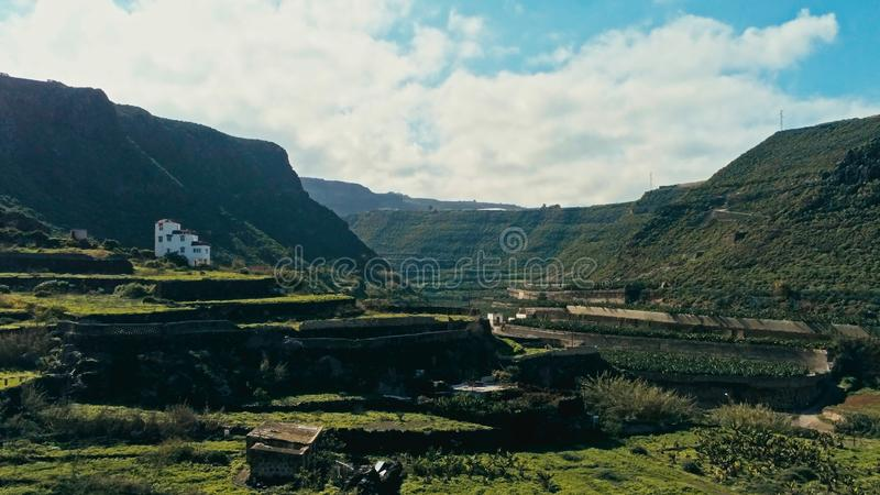 aerial drone image of beautiful stunning landscape with fields and terraces for planting vegetables and fruits with a colonial royalty free stock photos