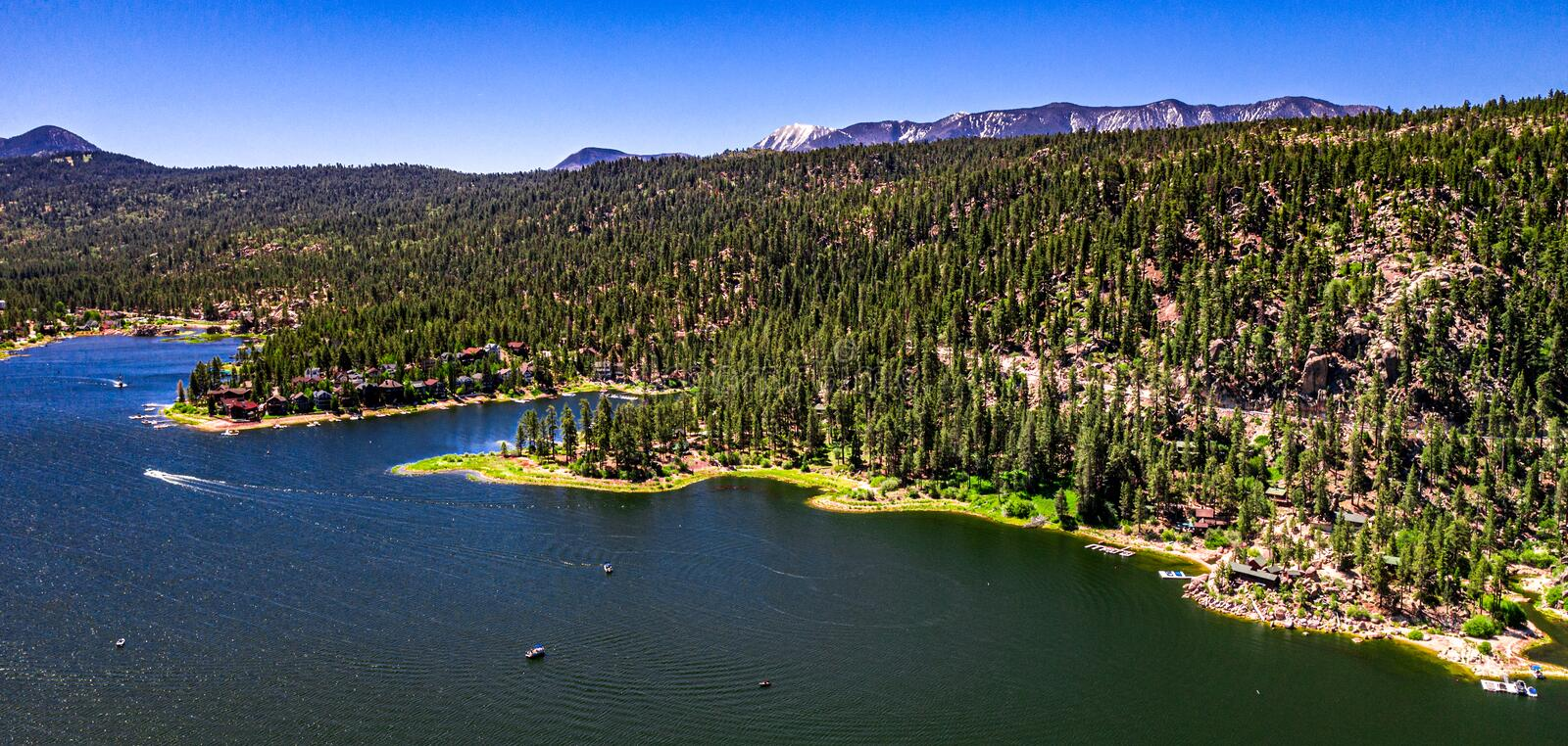 Aerial, Drone Landscape Over Big Bear Lake, California. Aerial, drone panorama of resort Big Bear Lake, California in the San Bernardino Mountains with clear royalty free stock photography