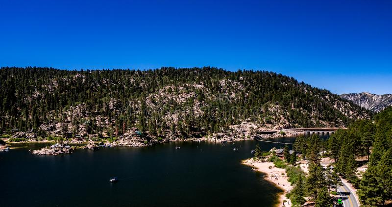 Aerial, Drone Landscape Over Big Bear Lake, California. Aerial, drone panorama of resort Big Bear Lake, California in the San Bernardino Mountains with clear royalty free stock photo