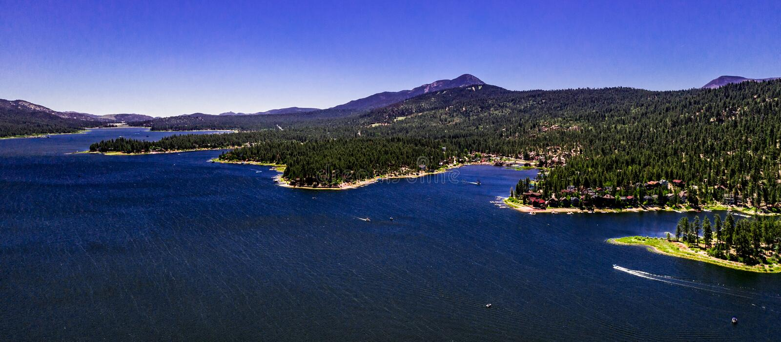 Aerial, Drone Landscape Over Big Bear Lake, California. Aerial, drone panorama of resort Big Bear Lake, California in the San Bernardino Mountains with clear royalty free stock photos
