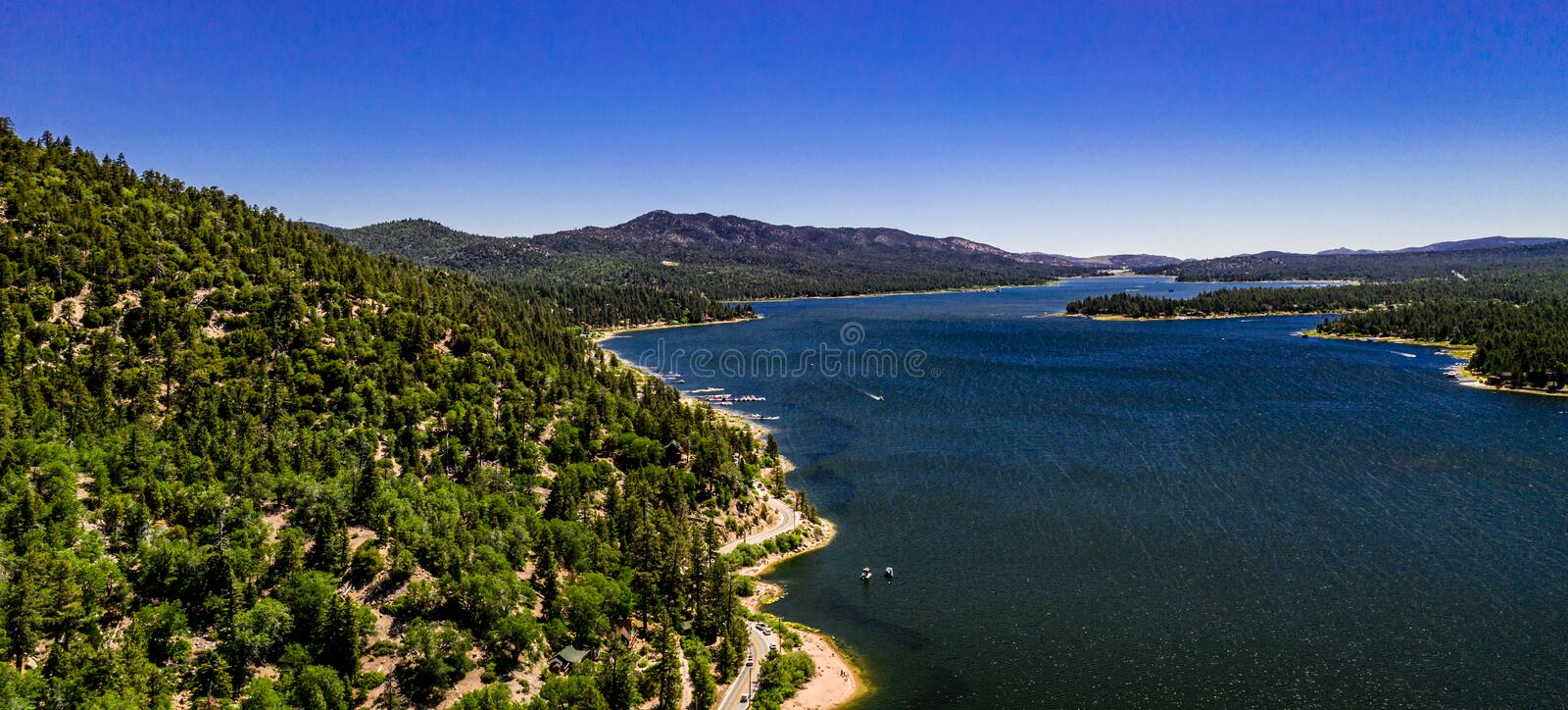 Aerial, Drone Landscape Over Big Bear Lake, California. Aerial, drone panorama of resort Big Bear Lake, California in the San Bernardino Mountains with clear stock photos