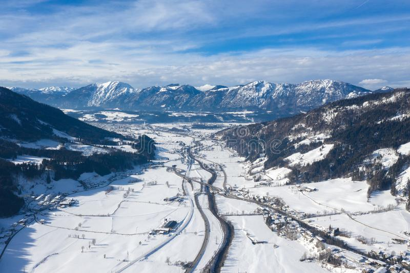 Aerial drone panorama of mountain valley, road and villages in cold winter day royalty free stock photo
