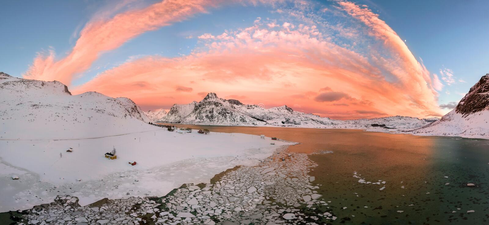 Aerial drone panorama photo. Beautiful sunset over the mountains and sea of the Lofoten Islands. Reine, Norway. Winter landscape w. Ith amazing colors stock image