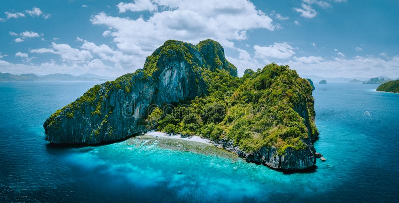 Aerial drone panorama picture of tropical paradise epic Entalula Island. Karst limestone rocky mountains surrounds the. Blue lagoon with beautiful coral reef royalty free stock photos