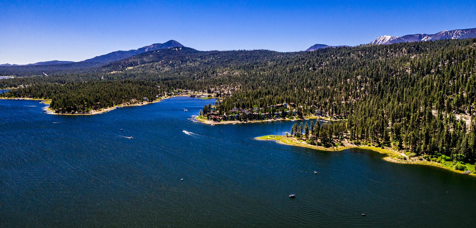 Aerial, Drone Landscape Over Big Bear Lake, California. Aerial, drone panorama of resort Big Bear Lake, California in the San Bernardino Mountains with clear royalty free stock images
