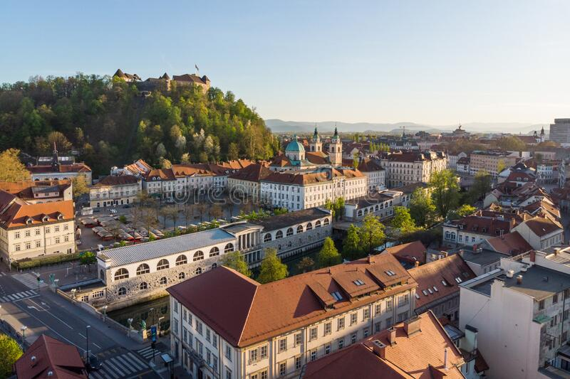 Aerial drone panoramic view of Ljubljana medieval city center, capital of Slovenia in warm afternoon sun. Empty streets royalty free stock image