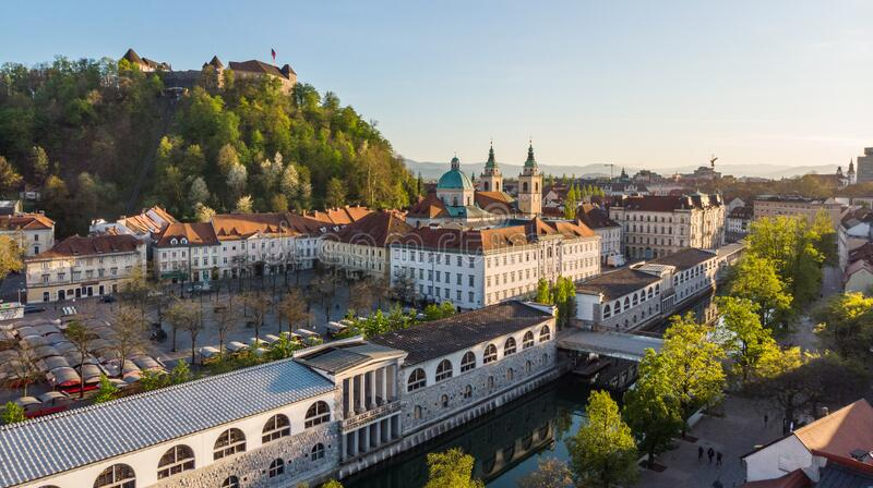 Aerial drone panoramic view of Ljubljana medieval city center, capital of Slovenia in warm afternoon sun. Empty streets royalty free stock images