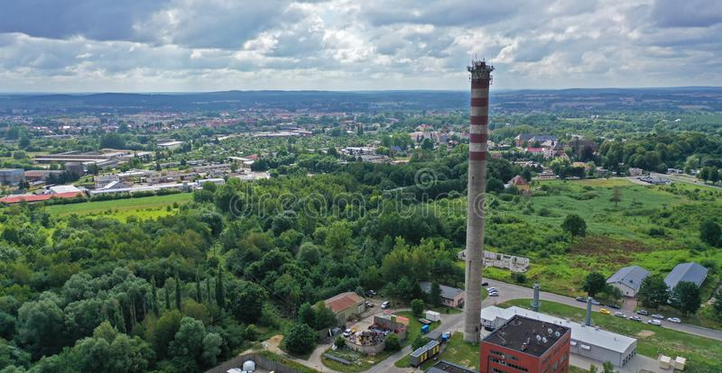 Aerial drone perspective view on high concrete chimney in heating plant close to the city stock images