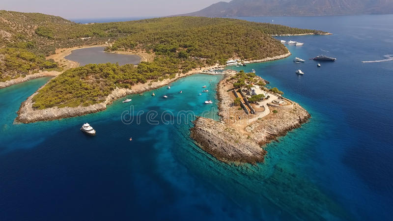 Aerial drone photo of Agistri island, Aponisos. Aponisos beach with clear waters in Agistri island, Saronic gulf, Greece royalty free stock photo