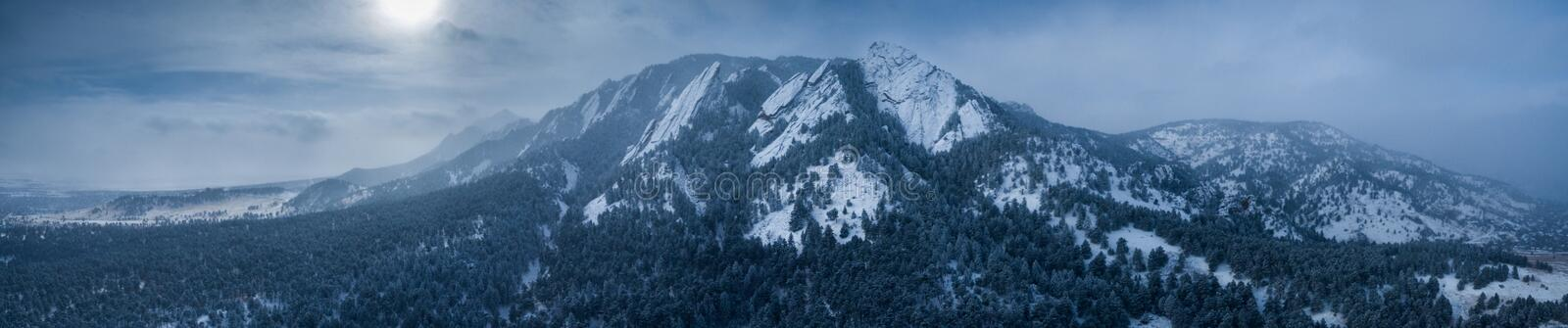 Aerial drone photo - Beautiful snow covered Flatirons mountains in Winter. Boulder, Colorado royalty free stock photos