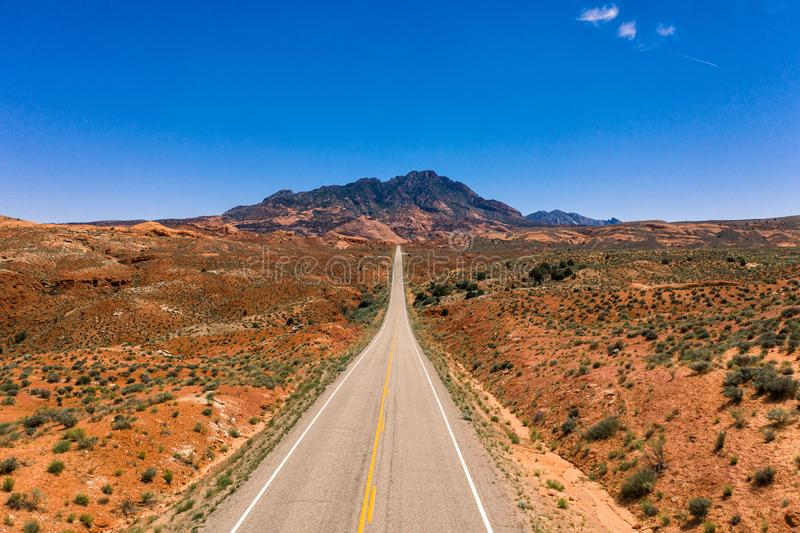 Aerial drone photo - A highway leads into the Henry Mountains in the Utah desert. A beautiful highway leading into the mountains and desert of Utah royalty free stock images