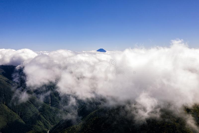 Aerial drone photo - Mt. Fuji rising above the clouds royalty free stock photography