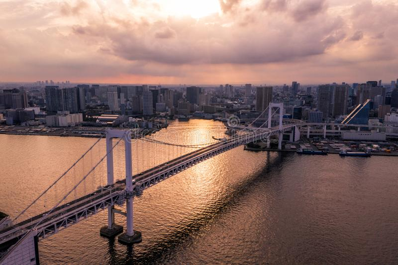 Aerial drone photo - Rainbow Bridge and the skyline of Tokyo at sunset. Capital city of Japan. royalty free stock image