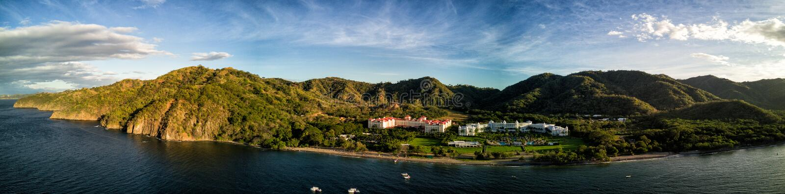 Aerial Drone Photo - Resort hotels along the Pacific coast of Costa Rica, surrounded by rugged mountains stock image