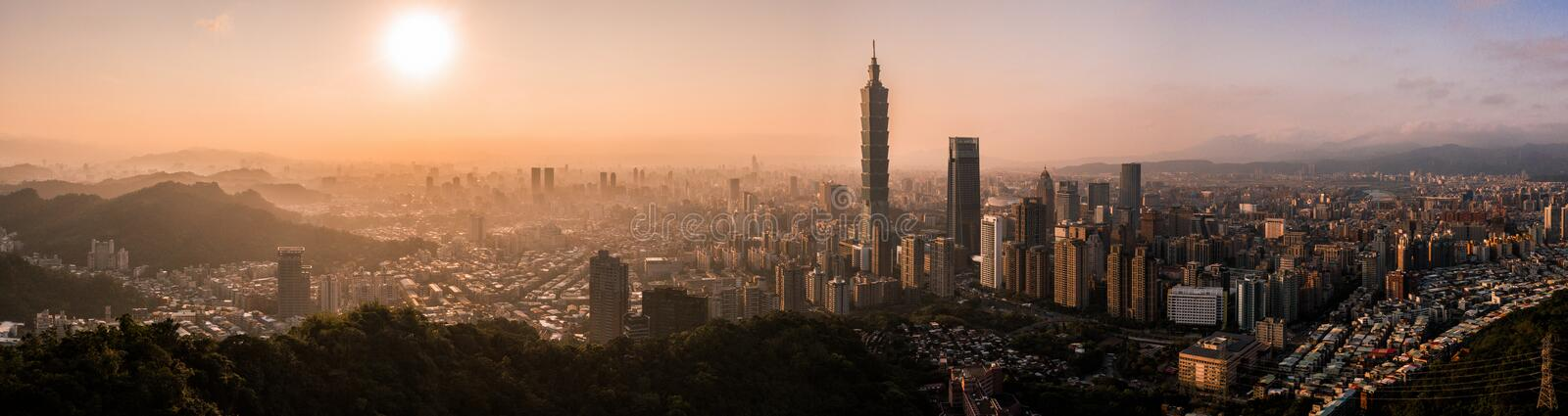 Aerial drone photo - Sunset over Taipei skyline. Taiwan. Taipei 101 skyscraper featured. royalty free stock photos