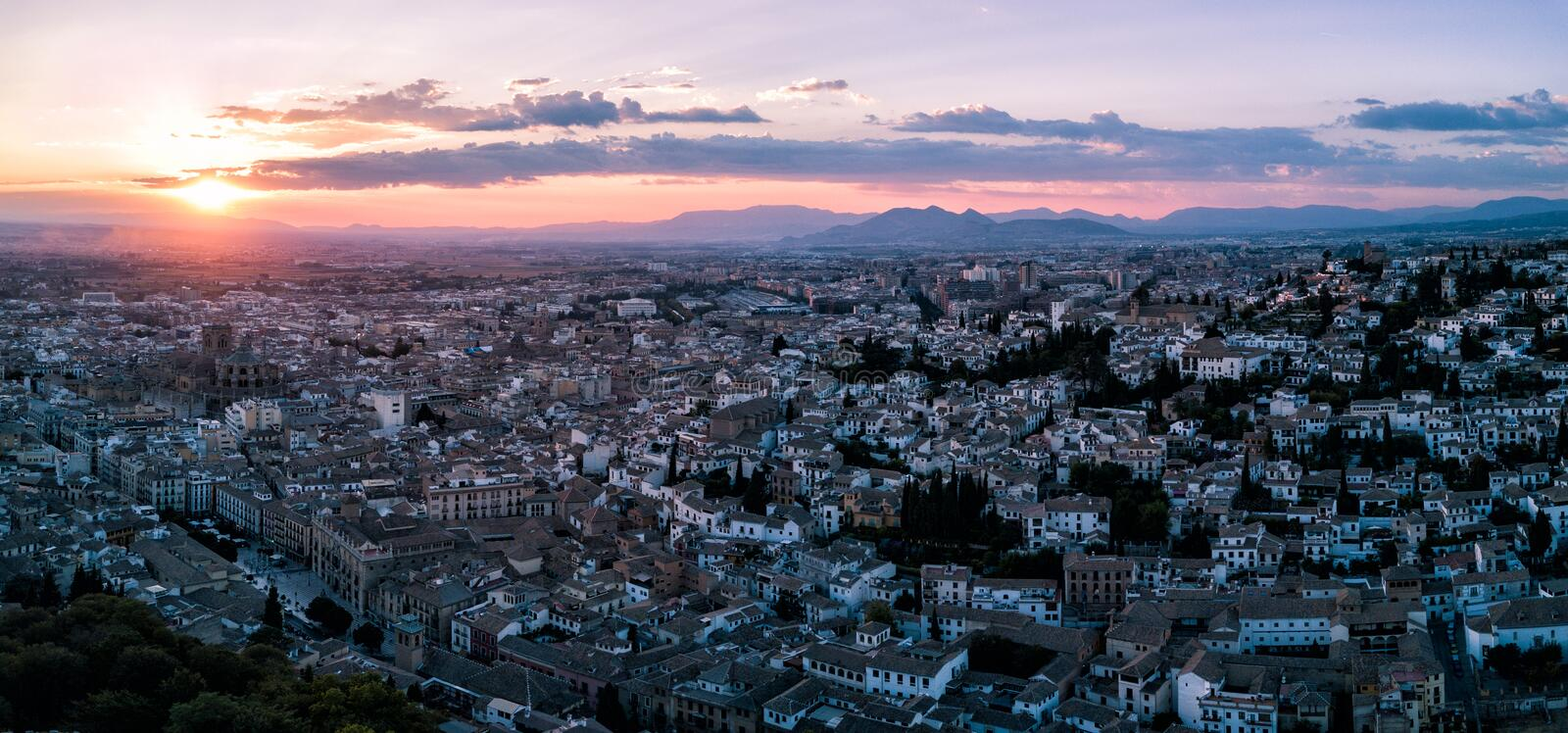 Aerial drone photograph of the city of Granada Spain at sunset royalty free stock photos