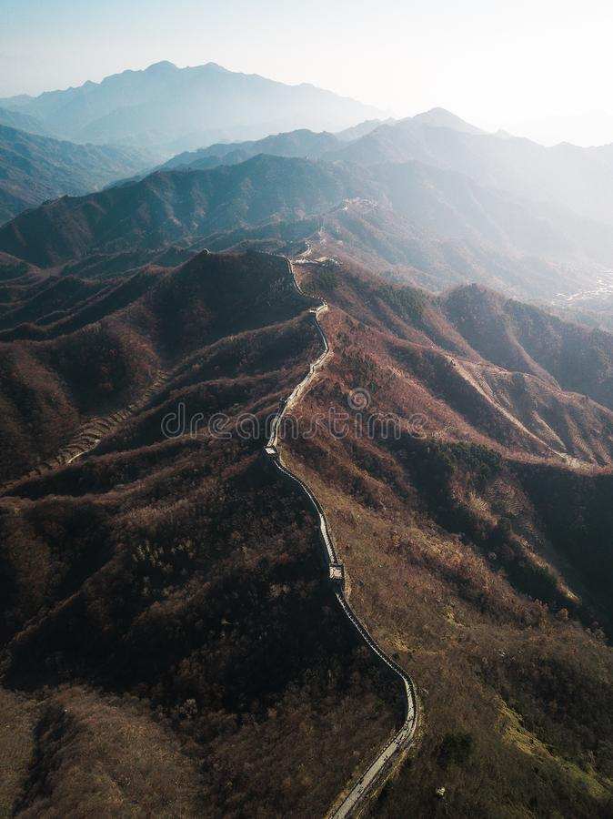 Aerial drone photography of the Great Wall of China with sunlight shining on the side stock photography