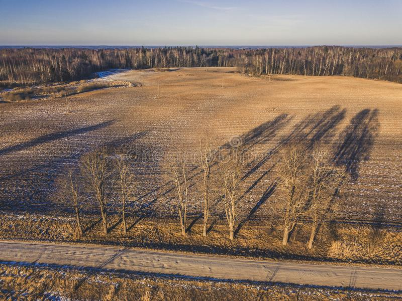 Aerial Drone Photography of a Road in Sunny Winter Day - vintage stock photography