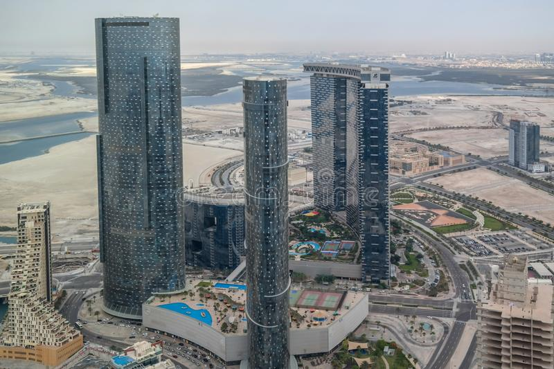 Aerial drone shot of Al Reem island Sun and Sky towers and other landmarks in Abu Dhabi city, UAE.  stock photo