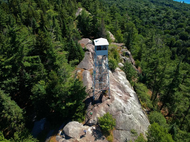 Aerial drone shot of firetower on the summit in the Adirondack Mountains royalty free stock photo