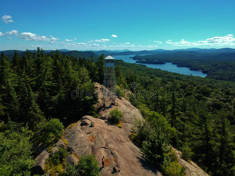 Aerial drone shot of firetower on the summit in the Adirondack Mountains stock photos