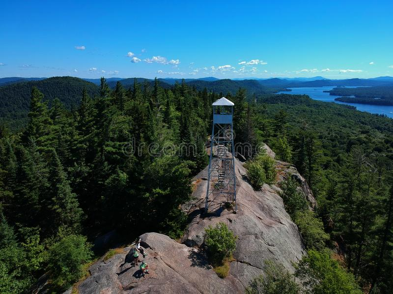 Aerial drone shot of firetower on the summit in the Adirondack Mountains royalty free stock photos