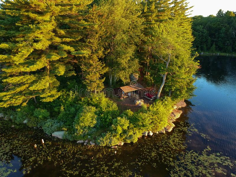 Aerial drone shot of lean to Campsite and campfire in the Adirondack Mountains royalty free stock photography