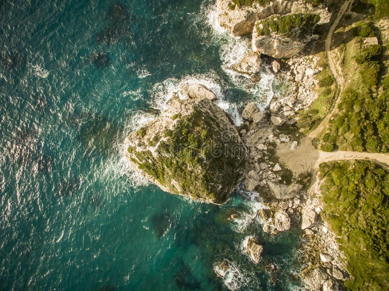 Aerial drone shot of rocks and the sea at Corfu Greece. .Amazing Greece royalty free stock photos