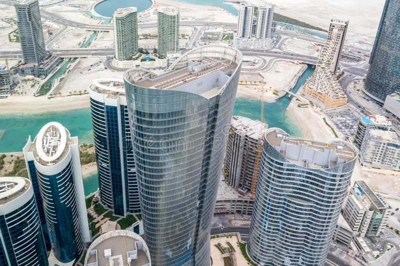 Aerial drone shot of skyscrapers and towers in the city - Abu Dhabi Al Reem island towers.  stock photos