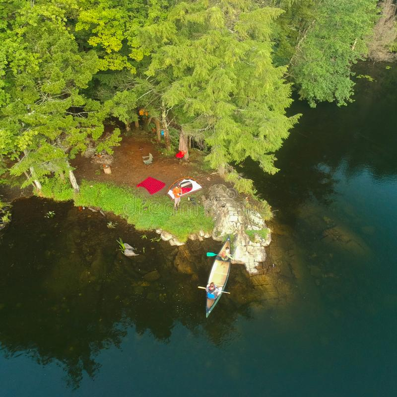 Aerial drone shot of tent Campsite,campfire and Canoe in the Adirondack Mountains stock photography