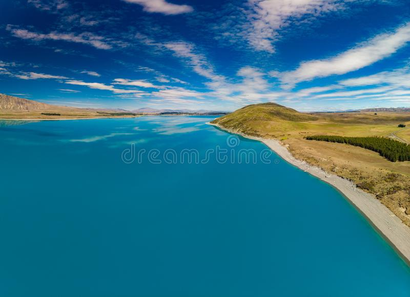 Aerial drone shots of Lake Tekapo with reflection of sky and mountains, New Zealand stock images